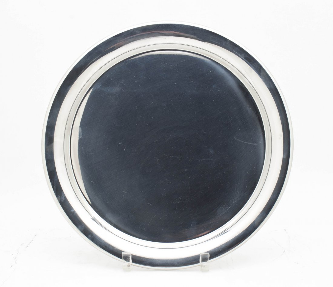 A Pewter Serving Tray, Cartier, Diameter 11 1/8 inches.