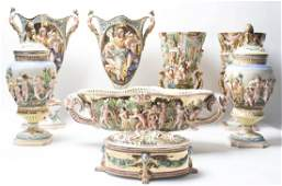 A Collection of Eight Capodimonte Porcelain Articles H