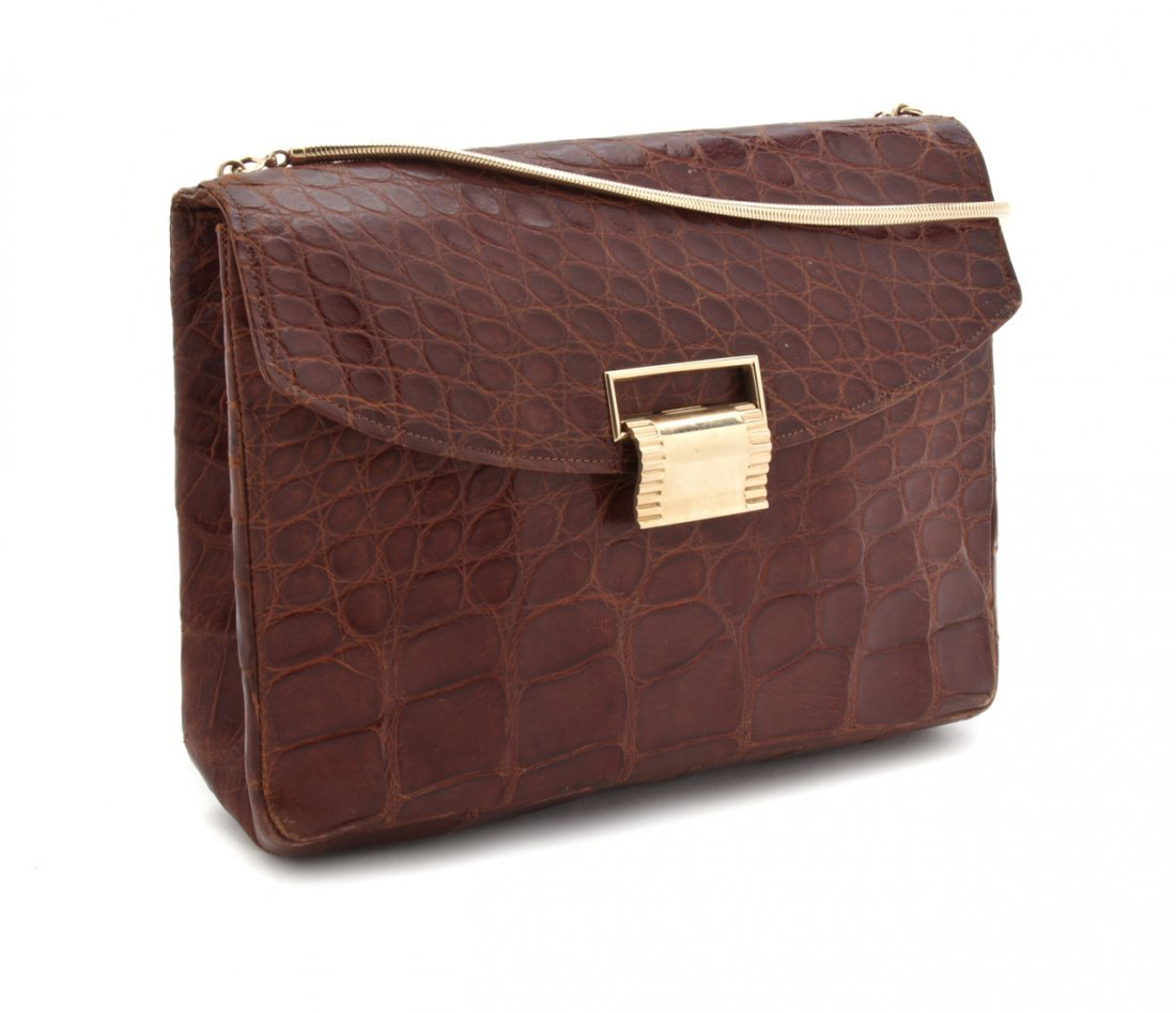A Cartier Cognac Alligator Bag, 9 x 8 x 3 inches.