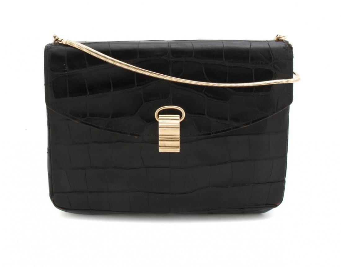 A Cartier Black Alligator Bag, 9 x 8 x 2 1/2 inches.