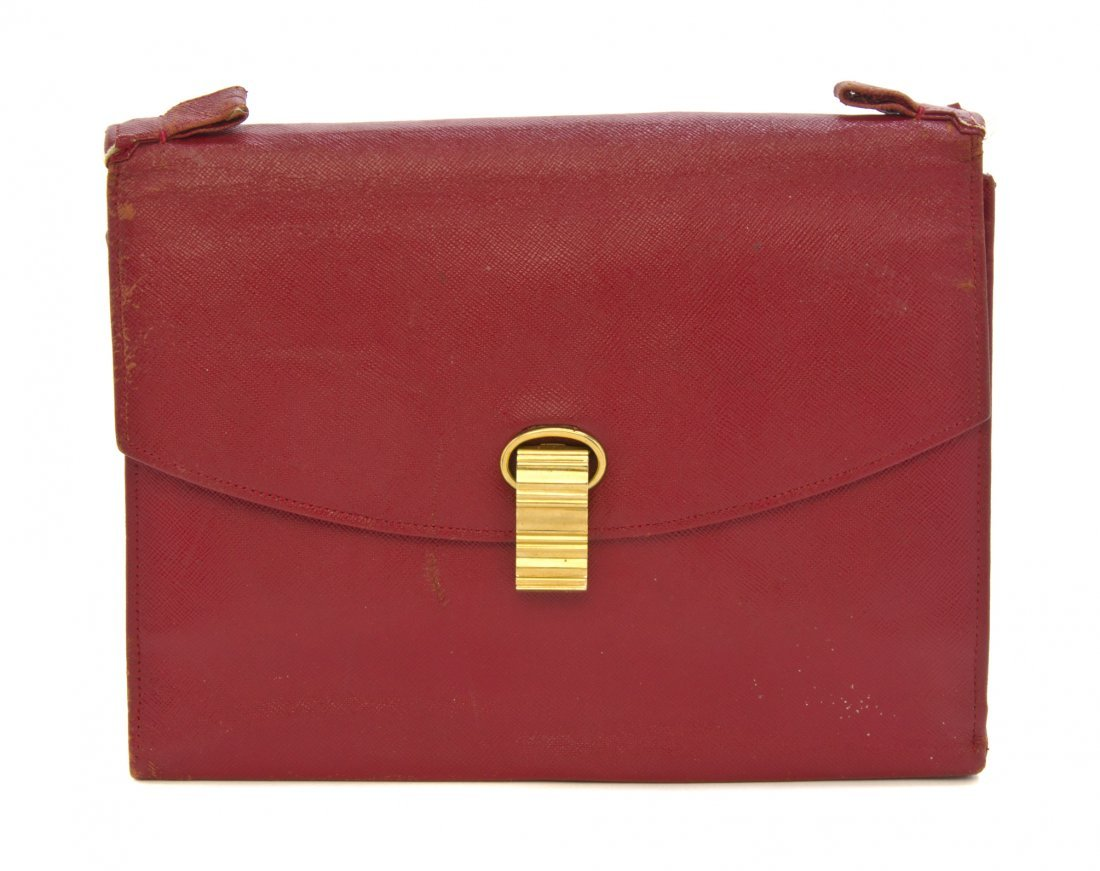 A Cartier Red Textured Leather Bag, 9 1/2 x 7 1/2 x 2 i