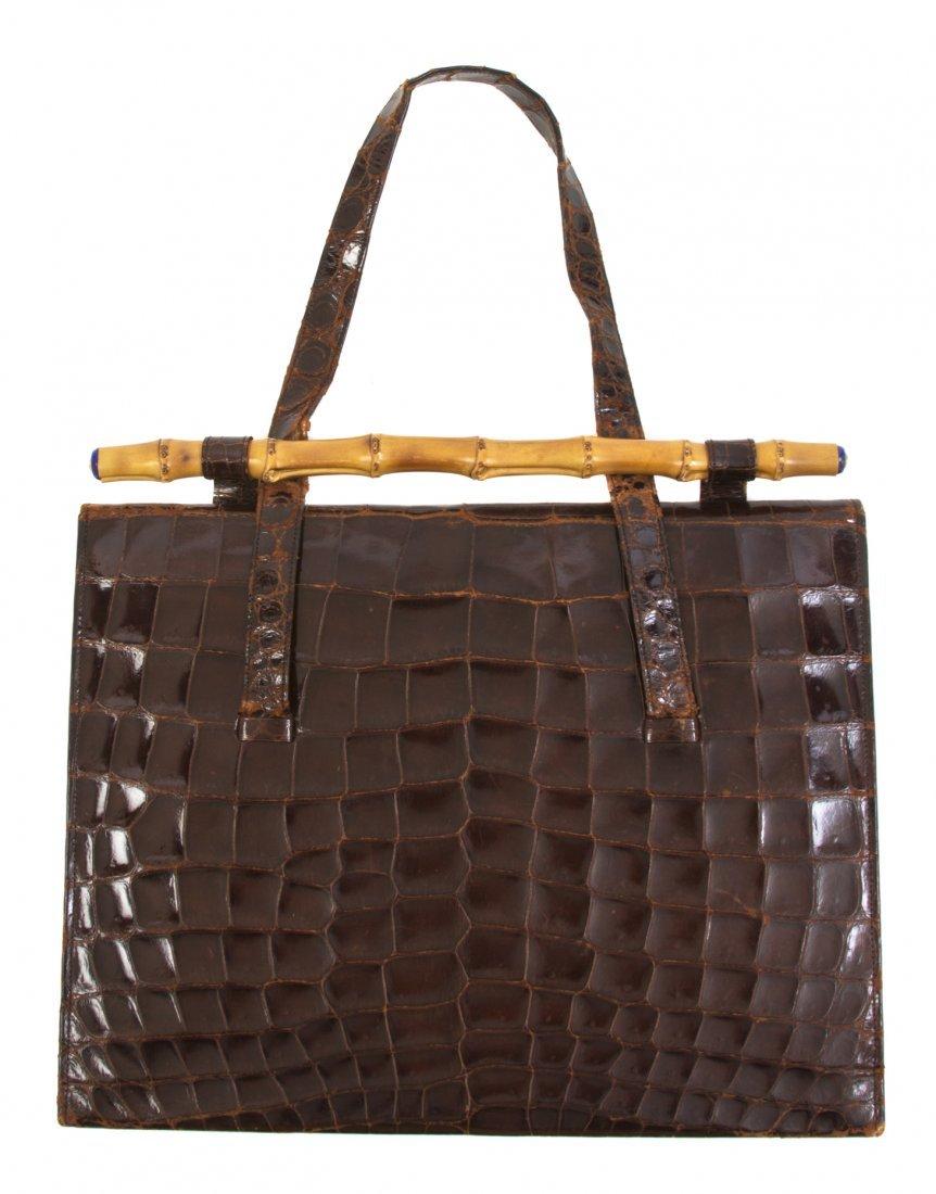 A Cartier Brown Crocodile Bag, 12 x 9 3/4 x 1 inch.