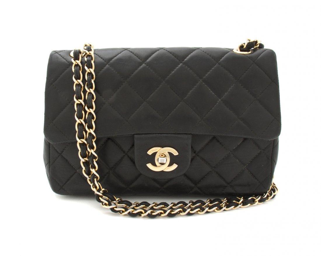 A Chanel Black Lambskin Bag, 9 x 5 x 2 1/2 inches.