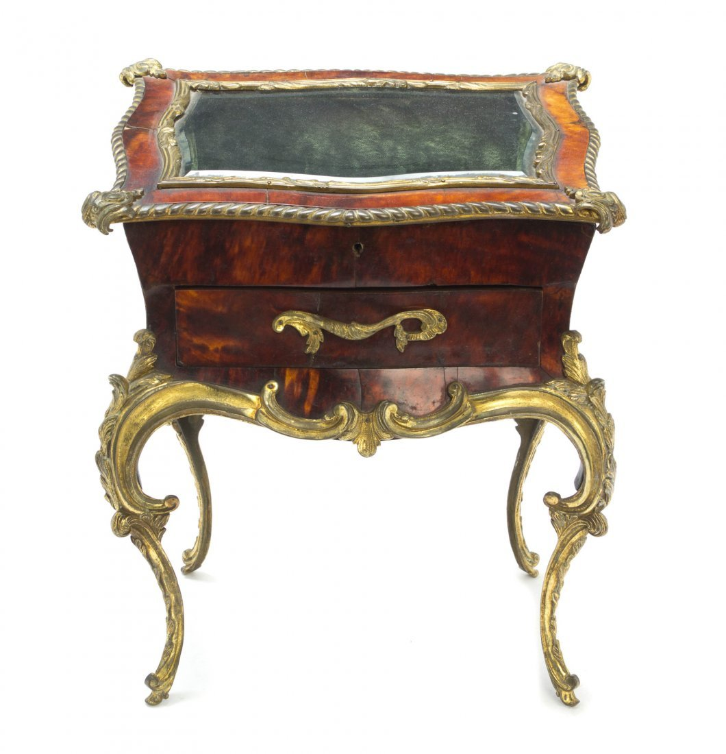 A Louis XV Style Tortoise Shell Veneered and Gilt Bronz