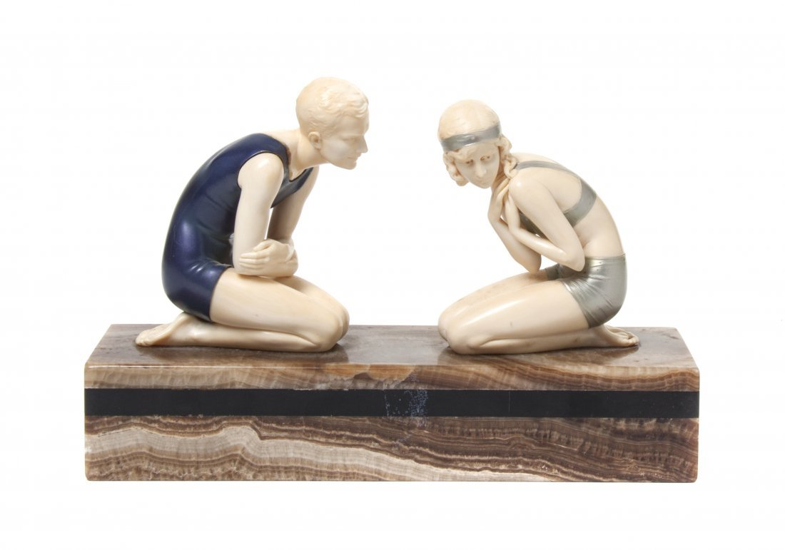 A German Cold Painted Bronze and Ivory Figural Group, F