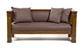 An Arts and Crafts Oak Settee, Height 33 1/2 x width 72