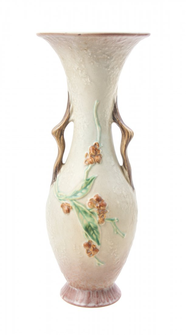 A Roseville Pottery Vase, Height 16 inches.