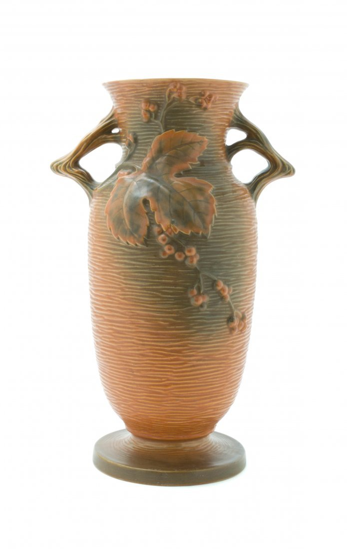 A Roseville Pottery Vase, Height 18 1/2 inches.