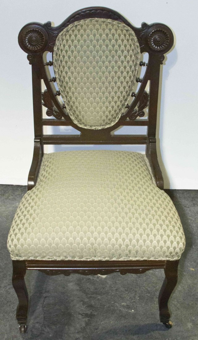 A Victorian Slipper Chair, Height 34 1/2 inches.
