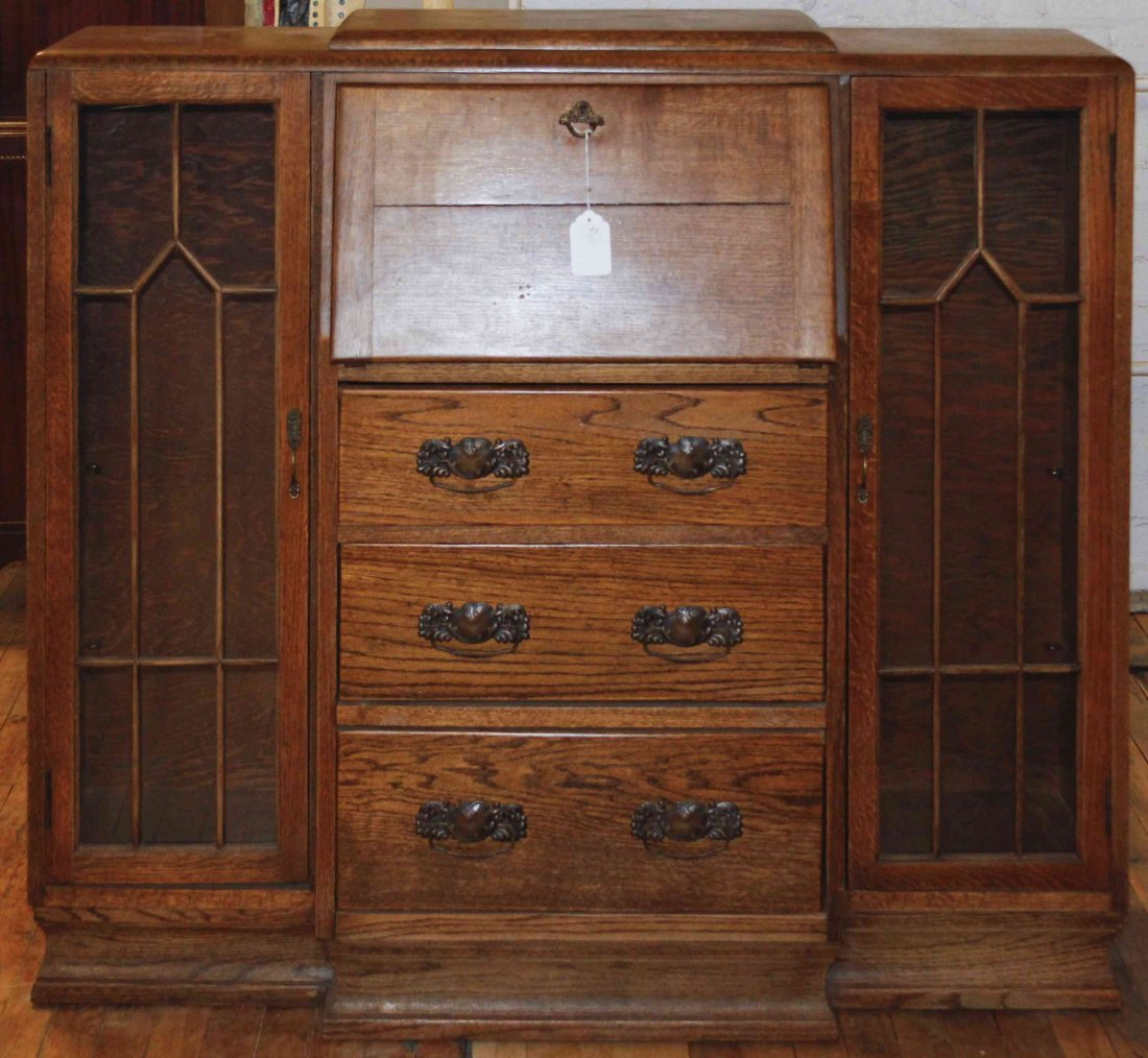 An Arts and Crafts Oak Secretary, Height 42 1/2 x width