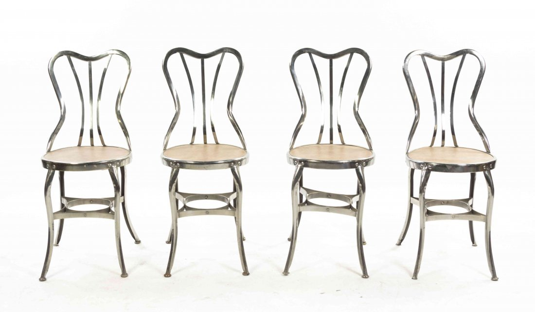 A Set of Four Chromed Cafe Chairs, Height 34 inches.