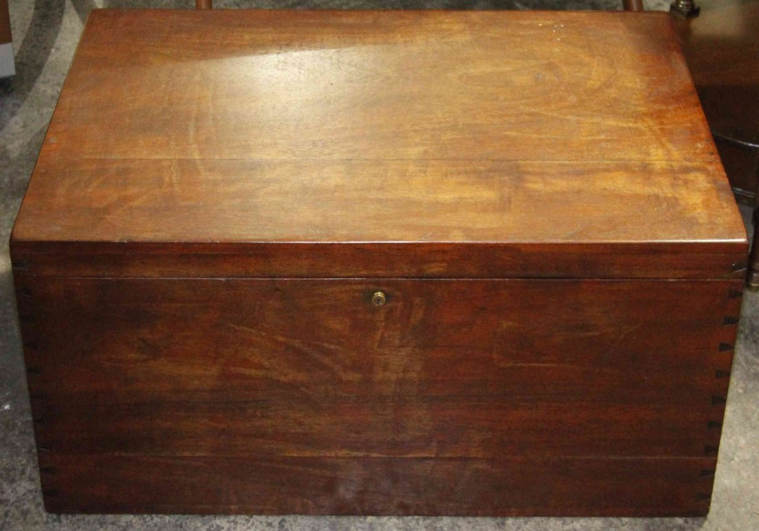 A Mahogany Trunk, Width 27 inches.
