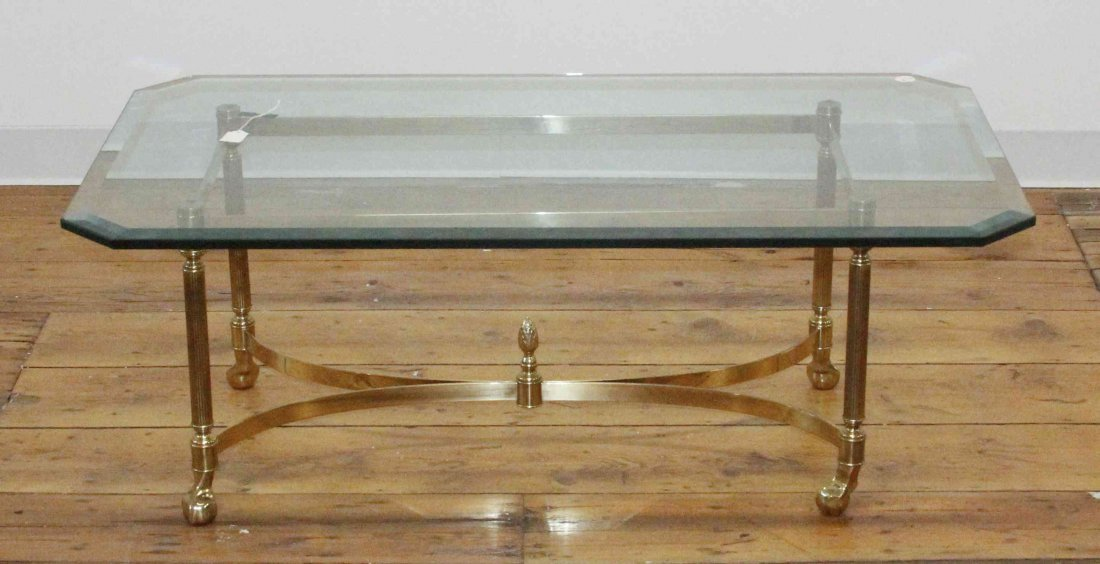 A Brass and Glass Low Table, Height 16 1/4 x width 43