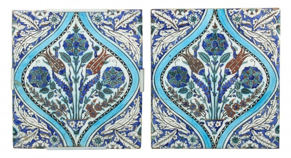 A Pair of Iznik Pottery Tiles, Height 14 x width 12 3/4