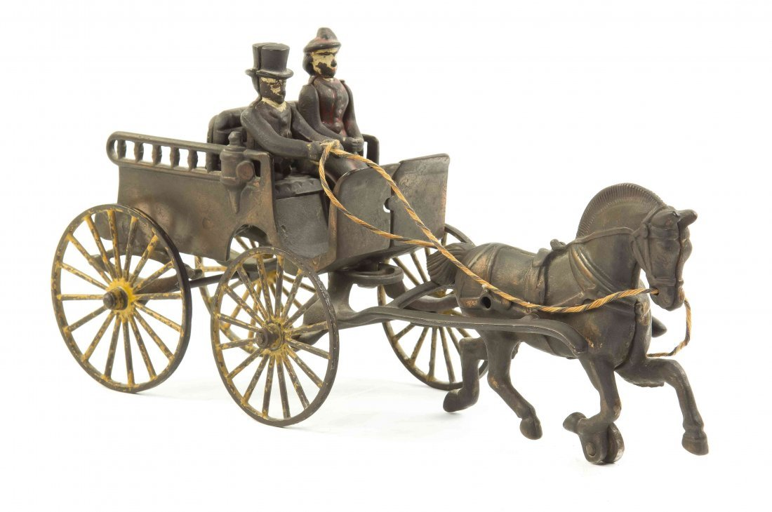 An American Cast Iron Carriage, Length 12 1/2 inches.