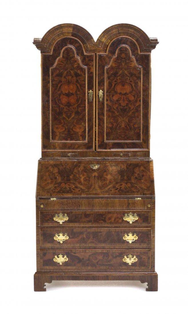 A George II Style Mahogany Secretaire Bookcase, John J.