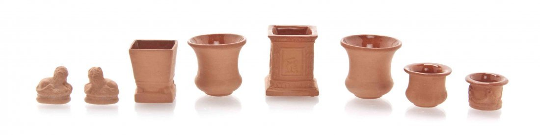 A Collection of Eight Terra Cotta Decorative Articles,