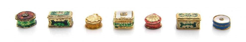 A Collection of Seven Gilt Silver Enameled Boxes,