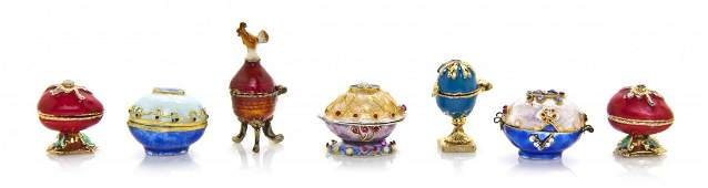 A Collection of Four Gilt Silver Enameled Egg Boxes,