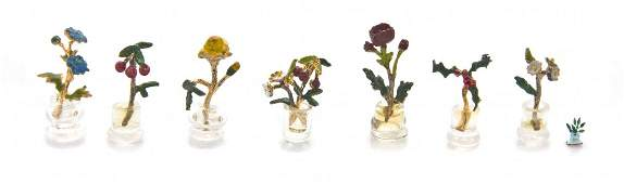 A Collection of Seven Gilt Silver Enameled Flowers,