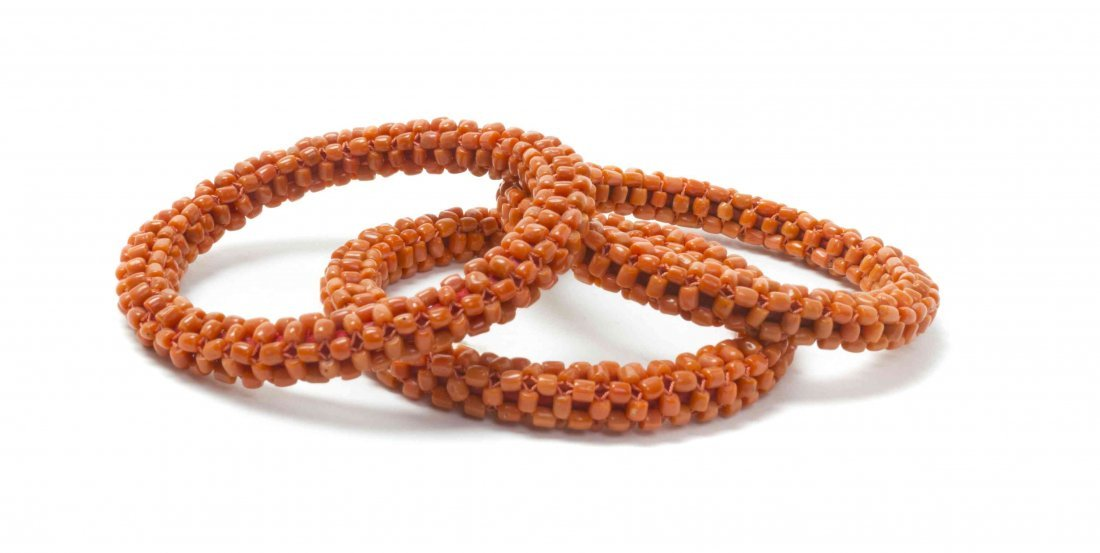 Three Coral Beaded Bangles, Diameter 3 3/4 inches.