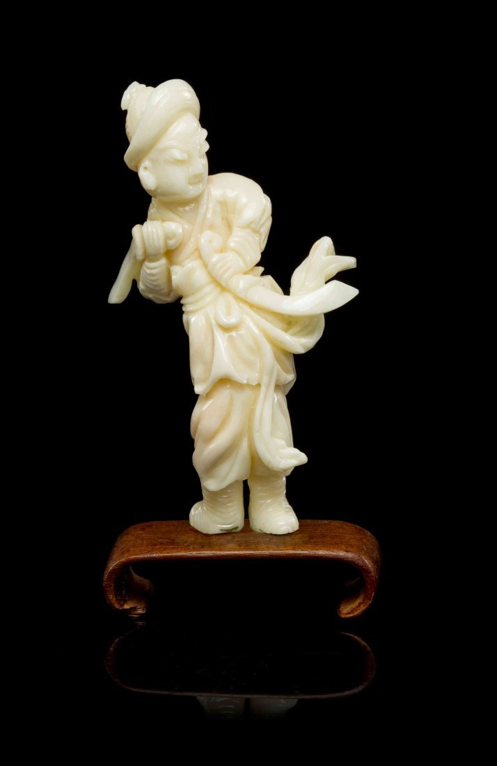 A Chinese Carved Coral Figure, Height 3 3/8 inches.