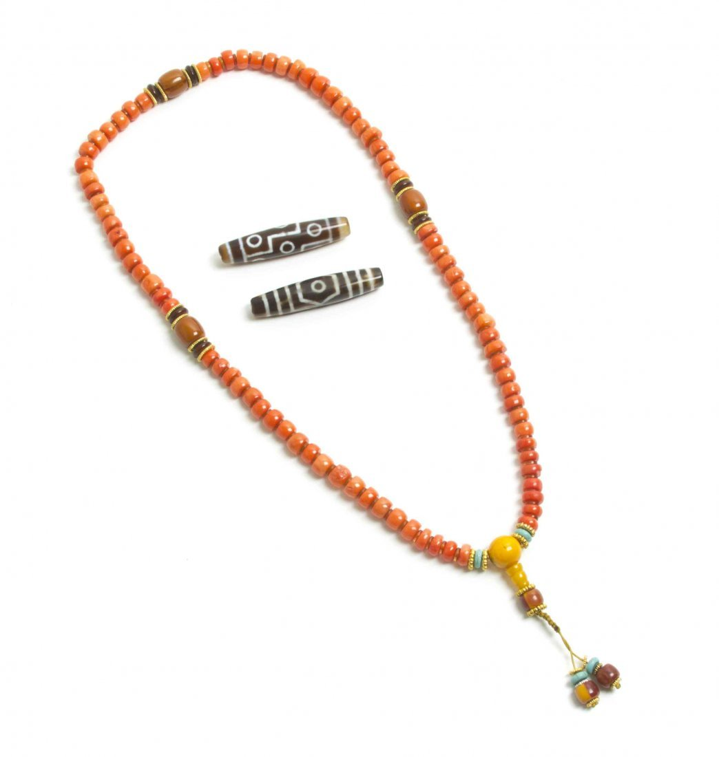A Coral Beaded Necklace, Length overall 15 1/8 inches.