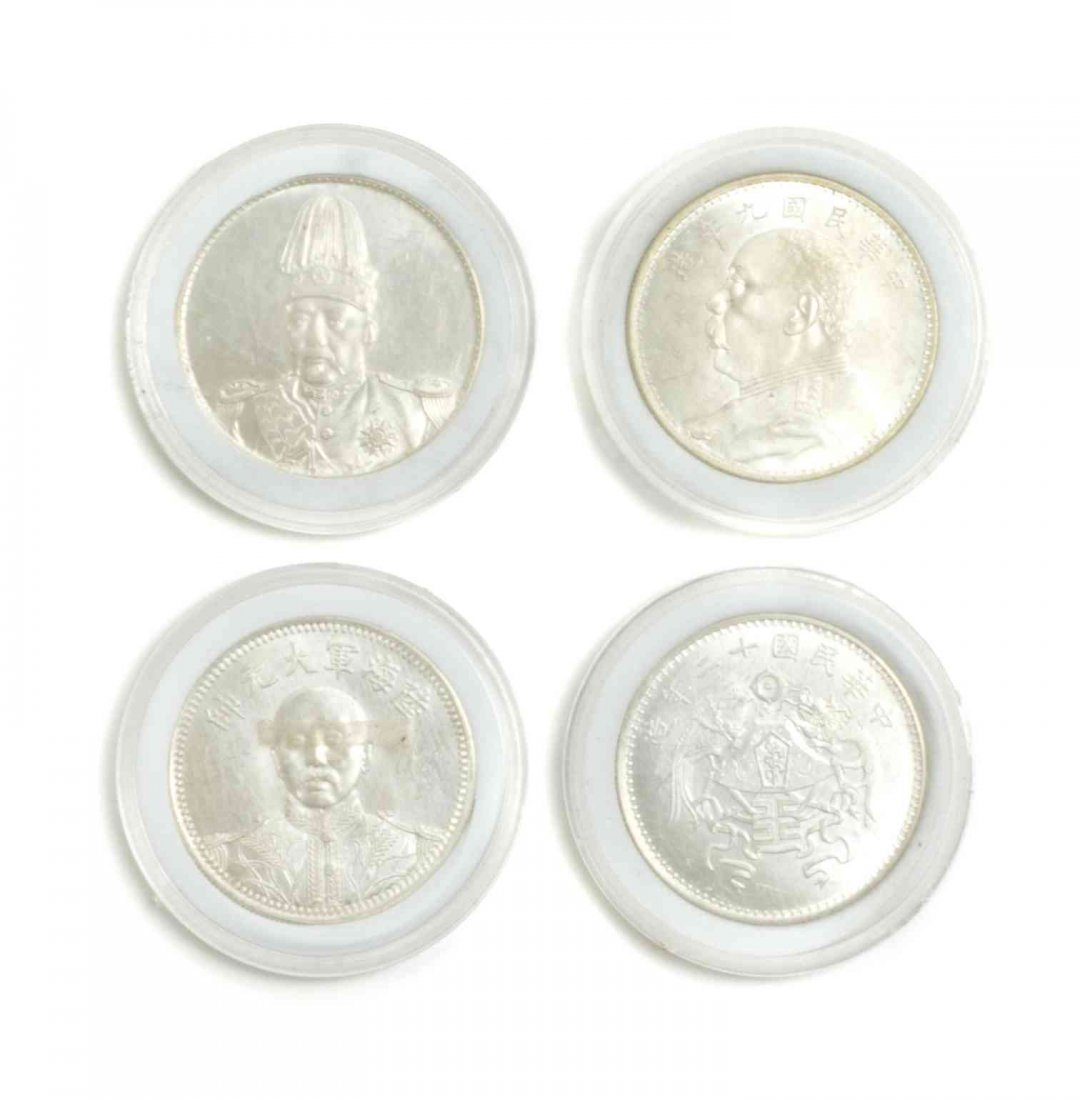 Four Chinese Coins. Diameter 1 1/2 inches.