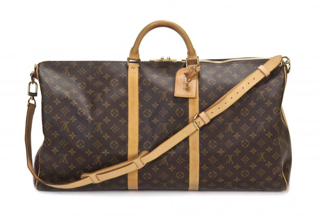 A Louis Vuitton Monogram Canvas Duffle Bag, 24 x 12 x