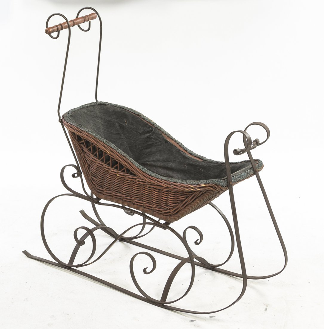 A Victorian Wrought Iron and Wicker Child's Sleigh,