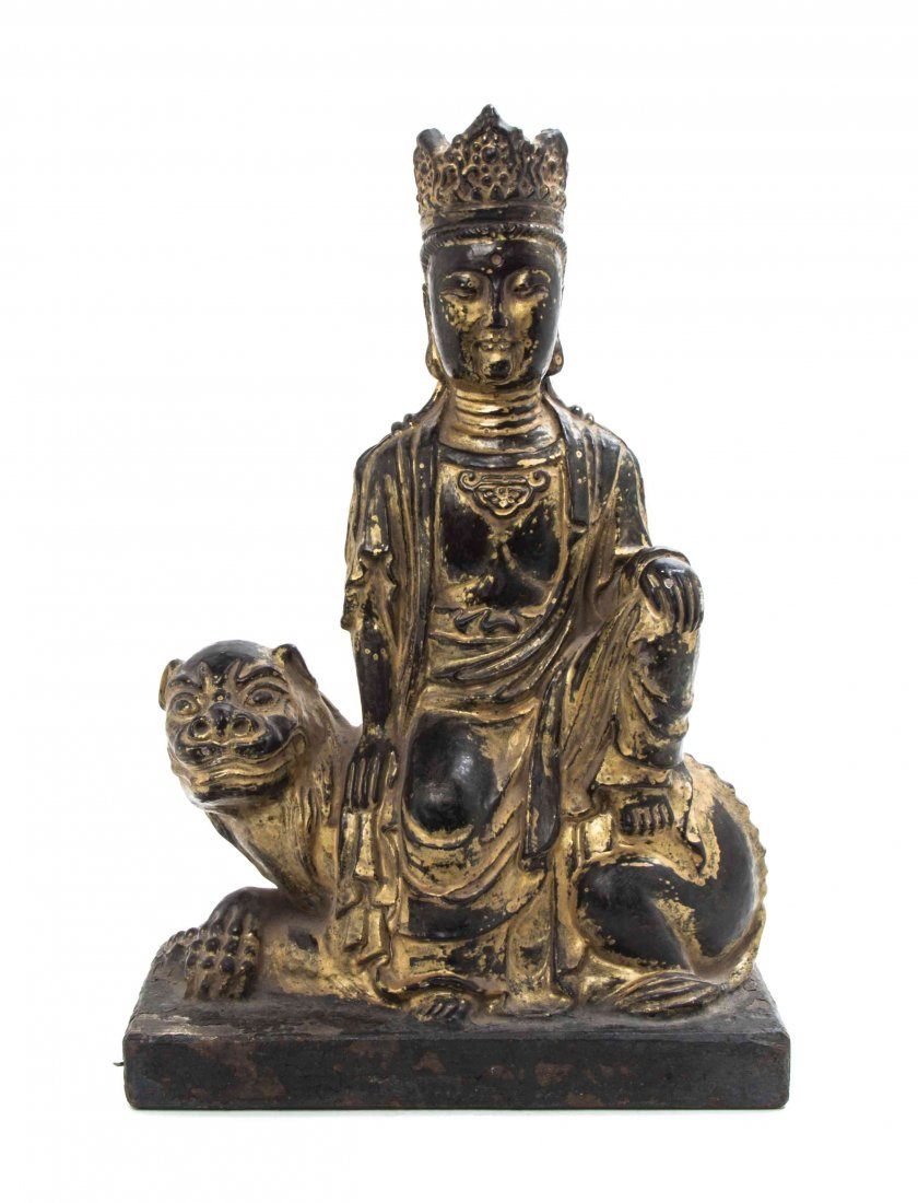 A Chinese Lacquer and Gilt Guanyin, Height overall 14