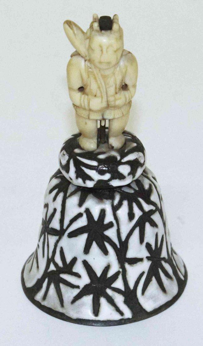 A Japanese Carved Ivory Okimono of a Figure, Height 3