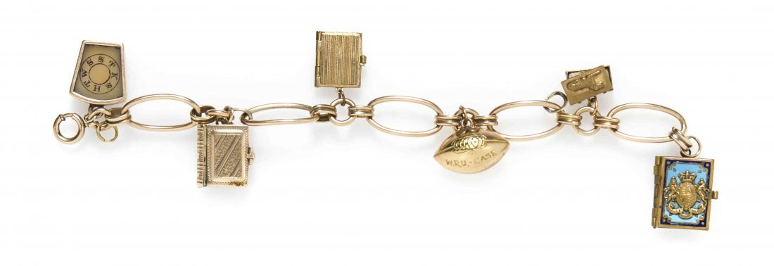 An Antique Gold Tone Charm Bracelet with Five Attached