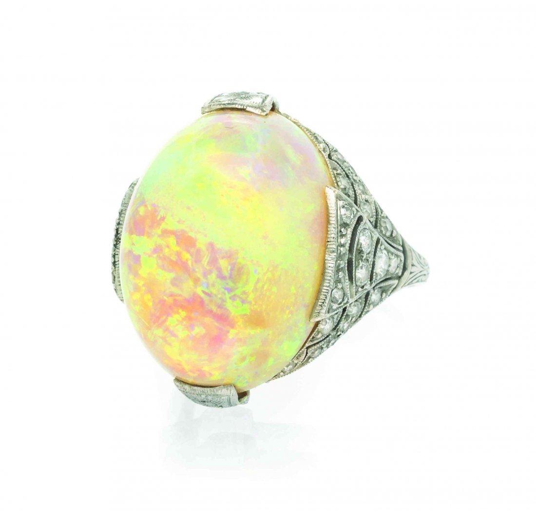 An Art Deco Platinum, Opal, and Diamond Ring