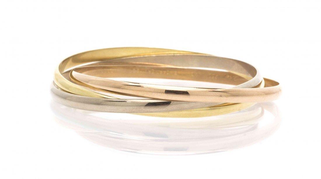 An 18 Karat Gold Trinity Bangle Bracelet, Cartier,