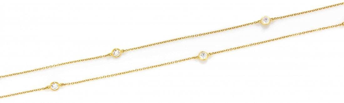 An 18 Karat Yellow Gold and Diamond Diamonds by the