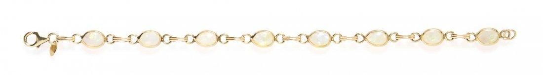 A 14 Karat Yellow Gold and Opal Bracelet, 3.90 dwts.