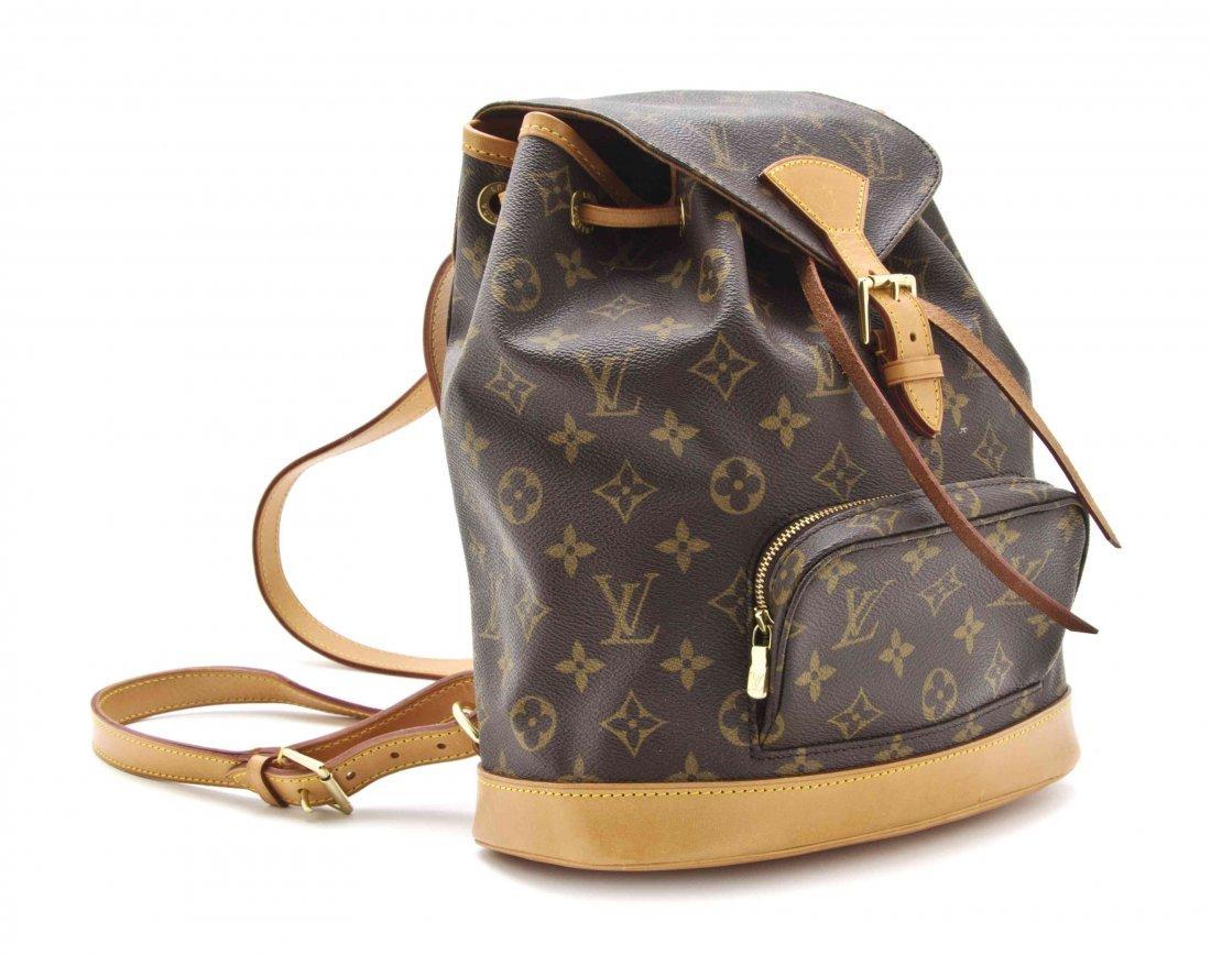 A Louis Vuitton Monogram Backpack, 9 1/5 x 11 x 3 1/5