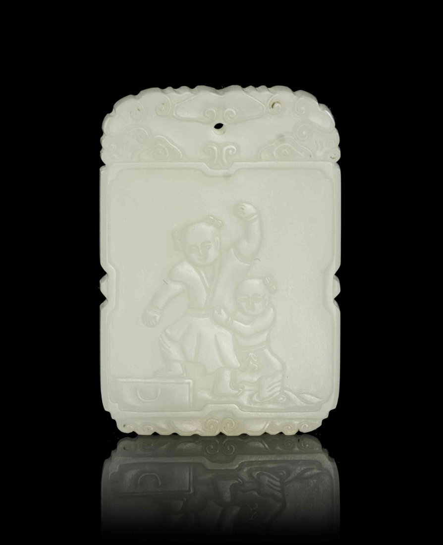 A Carved White Jade Plaque, Height 2 1/8 inches.