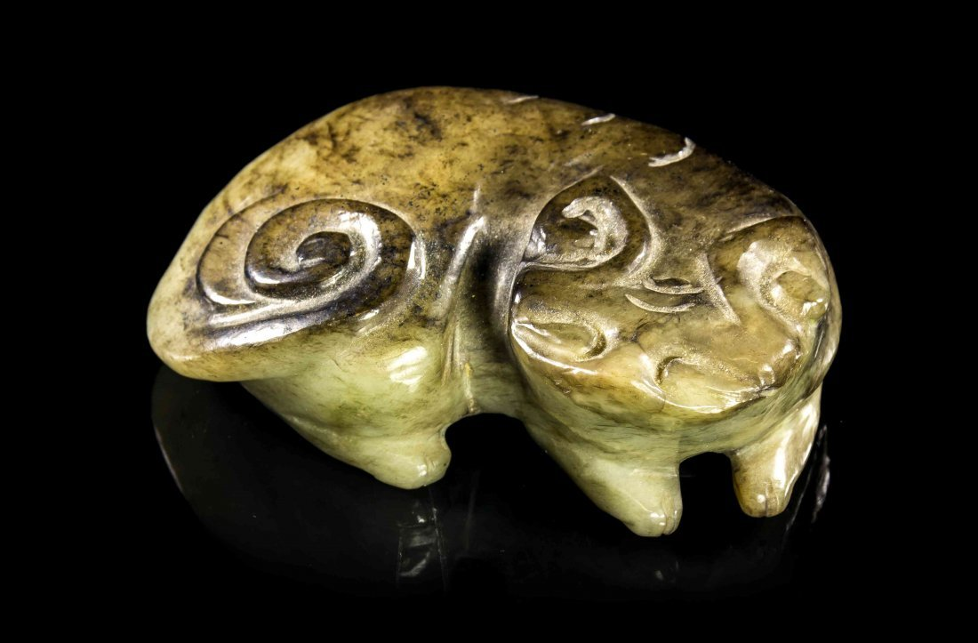 A Carved Jade Figure of a Qilin, Width 4 inches.