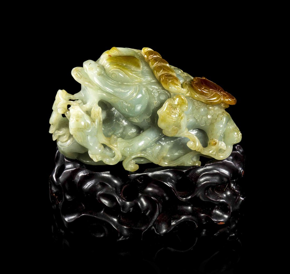A Carved Jadeite Figure of a Three-Legged Toad, Width 4