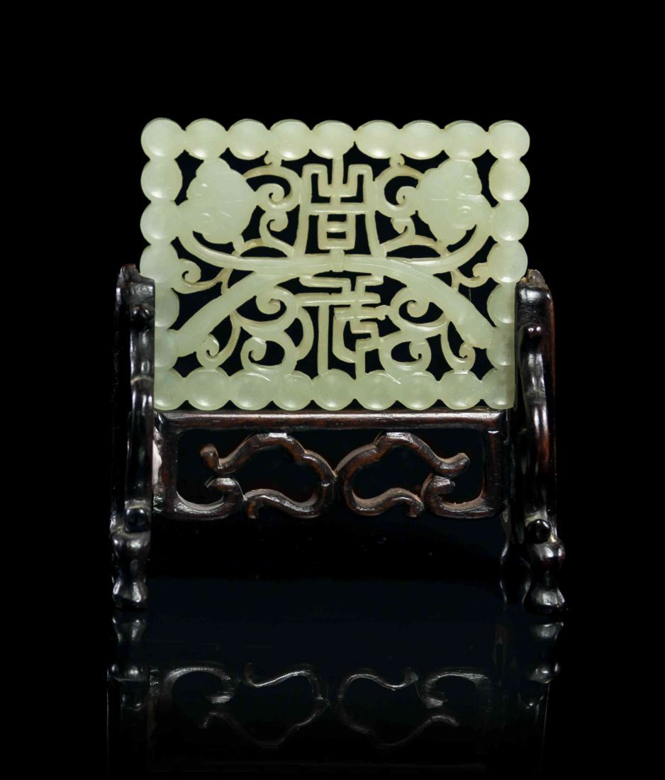 A Pierce Carved Jade Plaque, Width 3 1/2 inches.