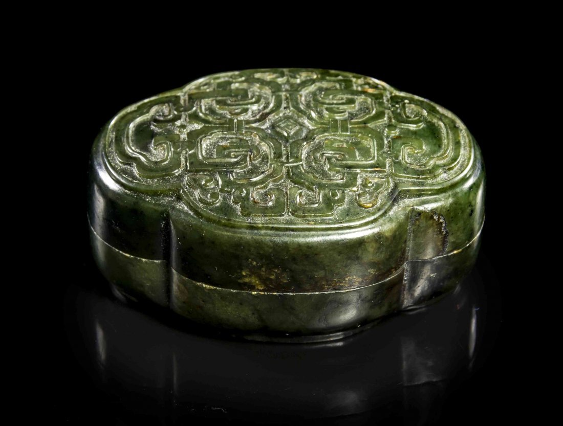 A Carved Jade Lidded Box, Width 3 1/2 inches.
