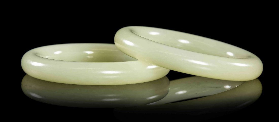 A Pair of Carved White Jade Bangles, Diameter 3 1/4