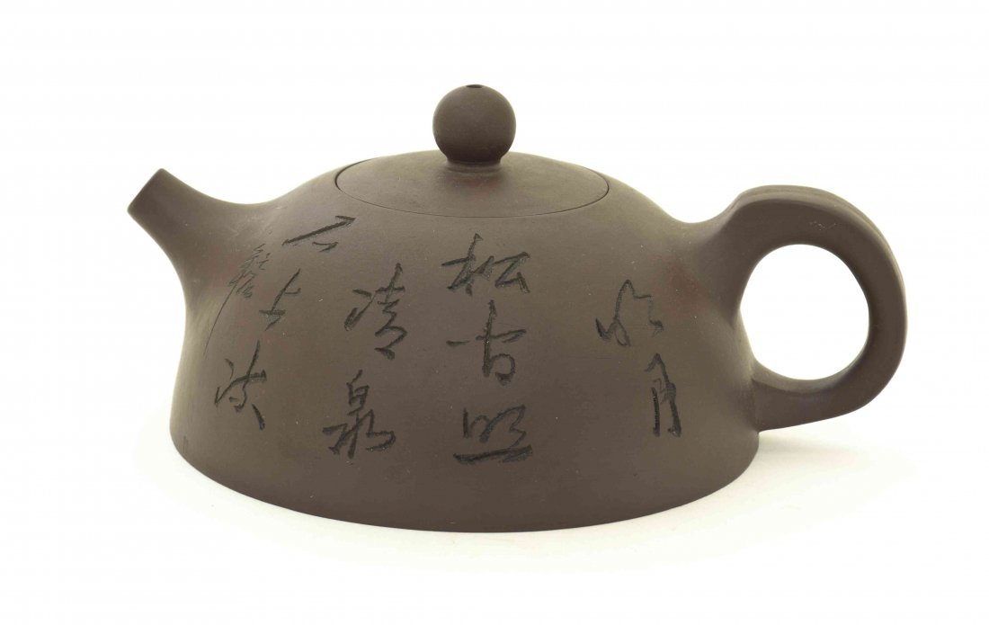 A Chinese Yixing Pottery Teapot, Width over handles 5