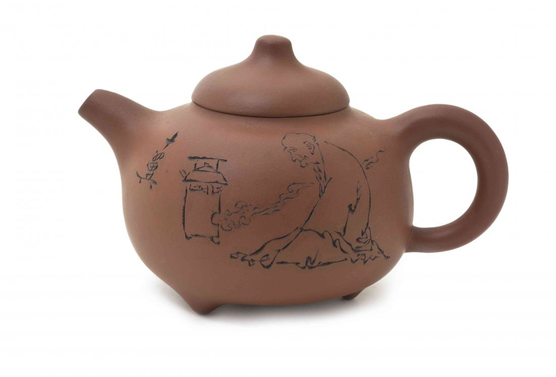 A Yixing Pottery Teapot, Width at widest 6 1/8 inches.