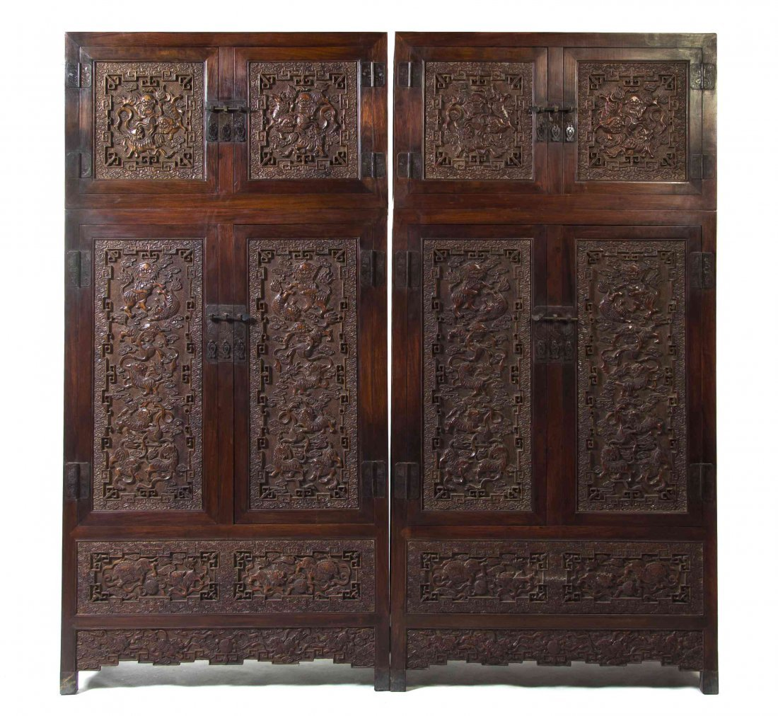 A Pair of Carved Hardwood Compound Cabinets, Height
