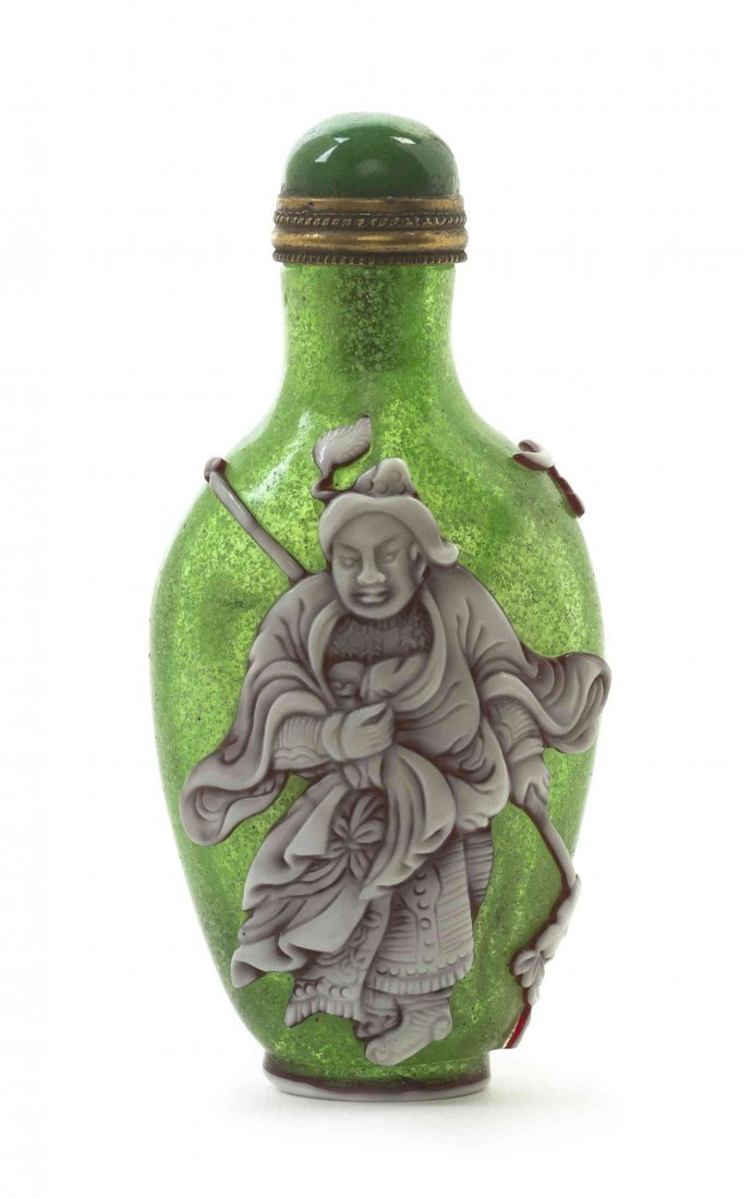 A Peking Glass Snuff Bottle, Height 2 7/8 inches.