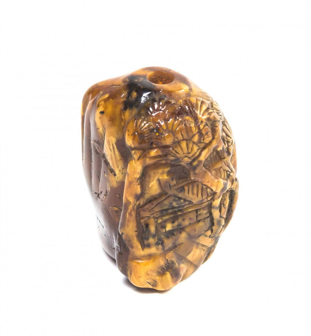 A Carved Amber Snuff Bottle, Height 2 inches.