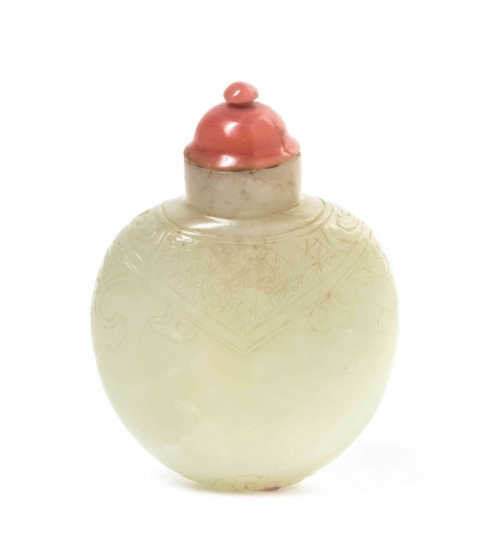 A Carved Jade Snuff Bottle, Height 2 1/8 inches.